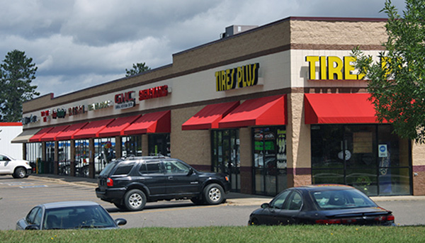 Commercial Storefront Awnings Installed by Rapid Garage Door & Awning in Grand Rapids, MN.